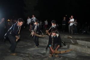 boys play khen h'mong instrument