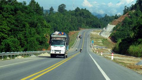 some trucks in new highway Hanoi Lao Cai
